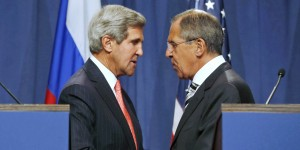 U.S. Secretary of State John Kerry, left, and Russian Foreign Minister Sergei Lavrov, shake hands after making statements following meetings regarding Syria, at a news conference in Geneva, Switzerland, Saturday Sept. 14, 2013. U.S. Secretary of State Kerry and Russian Foreign Minister Lavrov said Saturday they have reached an agreement on a framework for Syria to destroy all of its chemical weapons, and would seek a U.N. Security Council resolution that could authorize sanctions, short of military action, if Syrian President Bashar Assad's government fails to comply. (AP Photo / Larry Downing)